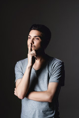 Portrait of a normal boy over grey background / Attractive young