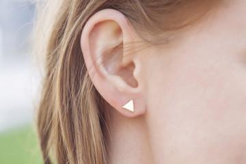 Woman ear wearing beautiful luxury earring Wall mural