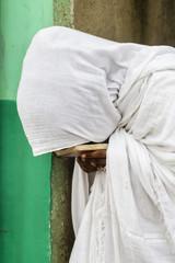 Close up of pilgrim praying in white robes