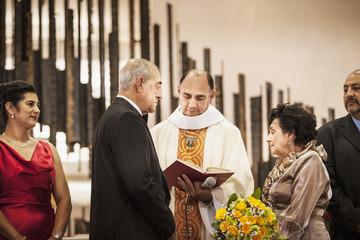 Senior couple exchanging vows at wedding