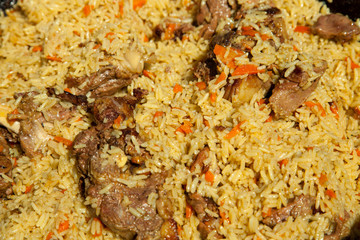 Arabic national rice food called pilaf cooked with fried meat, above