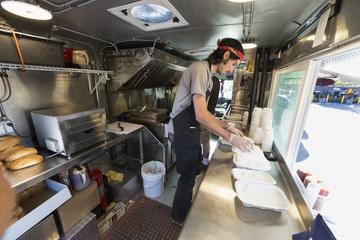 Caucasian chef working in food truck kitchen