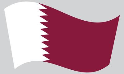 Flag of Qatar waving on gray background