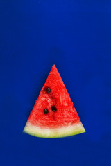 slice of watermelon on a blue background