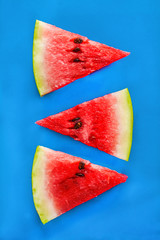 Tower of slices of watermelon on a blue background