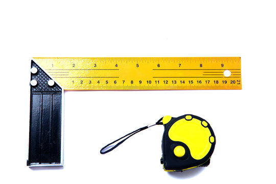 Iron ruler with angle bar, isolated on a white background with tape measure