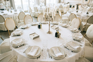 Elegant wedding reception white table arrangement restaurant, 