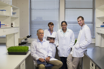 Portrait of smiling scientists in laboratory
