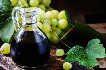Balsamic vinegar, vintage rustic background, selective focus