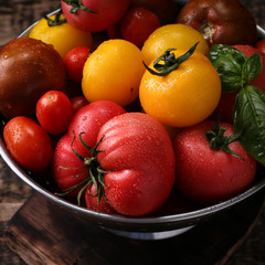 Colorful tomatoes, red tomatoes, yellow tomatoes, orange tomatoes, green tomatoes. Tomatoes background. vintage wooden background