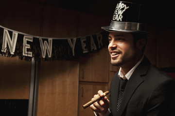 Hispanic man wearing hat for New Year's Eve