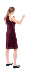 skinny woman funny fights waving his arms and legs. Isolated over white background. A girl in a burgundy dress sleeveless boxing.