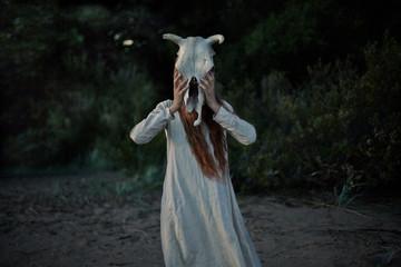 Caucasian woman wearing animal skull