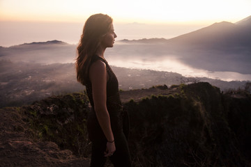 Woman admiring rural landscape from mountaintop