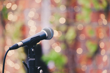 Microphone at outdoor concert againt bokeh background with vinta