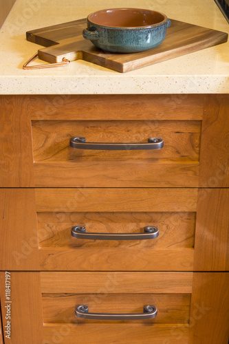 of high quality cherry wood cabinets with bronze cabinet hardware