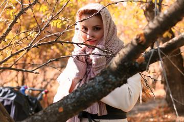 girl in a park wear a scarf autumn