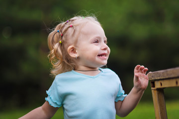happy little girl in the park