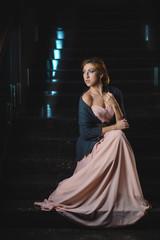 attractive woman in darken hall