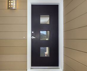 Front Door with square glass windows.