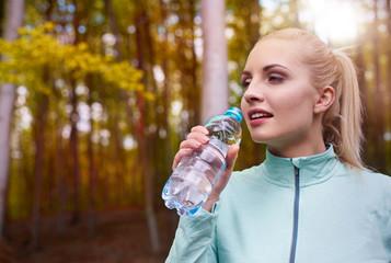 Bottle full of clear water.