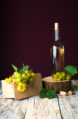 Bottle of white wine and grape