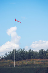Pennant in danish colors on a lawn