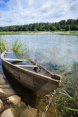 Chained wooden rowing boat