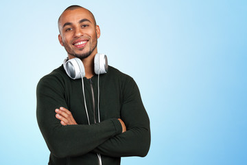 Handsome Afro American man is listening to music