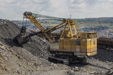 Large backhoe loader in the quarry in Ukraine