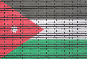 Jordanian flag painted on brick wall