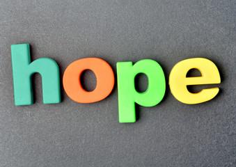 Hope on black background