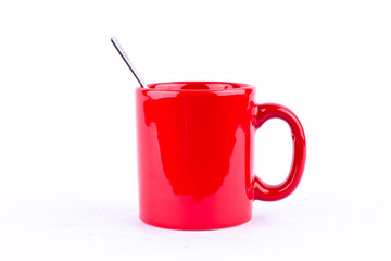red coffee or tea or milk mug cup and spoon on white background drink isolated