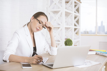 Attractive woman doing paperwork side