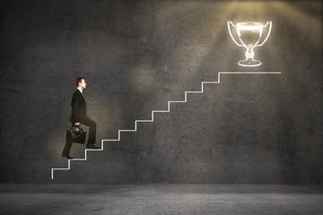 Business leader climbing ladder