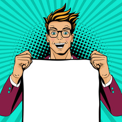 Wow pop art man. Young happy surprised man in glasses with open mouth holding empty poster for your offer. Vector colorful illustration in retro comic style. Vector pop art background.