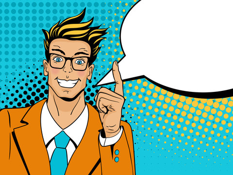 Wow pop art man. Young surprised man in glasses with open smile, raised index finger and speech bubble. Vector illustration in retro comic style. Colorful pop art background.