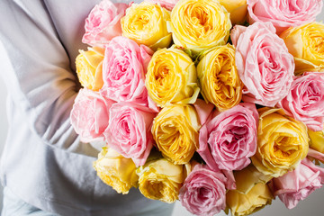bouquet of roses in hands  the florist.. Color pink.