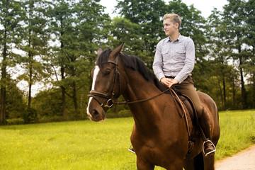man riding his horse on farmland