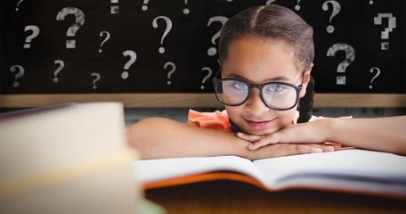 Composite image of little girl sitting at a desk