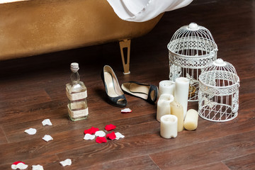 Romantic objects (candles, bird-cages, rose petals, shoes, empty