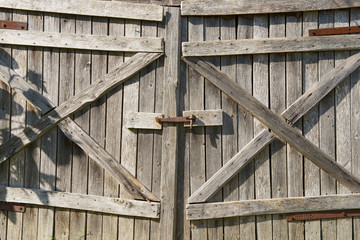 Old weathered wooden barn gate.