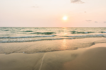 Wall Mural - Sunshine with gentle wave at the tropical beach in morning