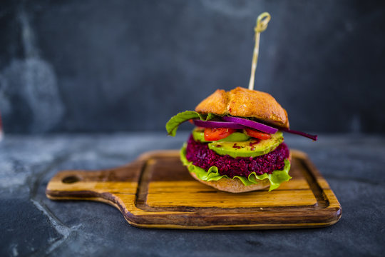 Veggie burger with beetroot and quinoa with fresh vegetables