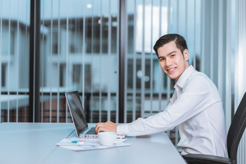 Young Businessman smile using laptop