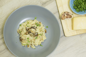 Risotto with mushrooms, parmesan cheese and parsley
