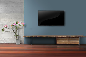 Living room led tv on blue concrete wall with empty wooden stand