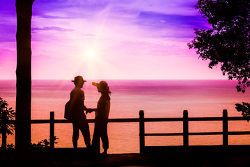Silhouette of romantic lovers on seascape backgrounds,love conce