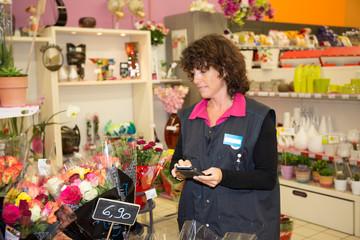 Portrait of female florist looking at flowers