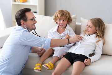 Man playing with his children